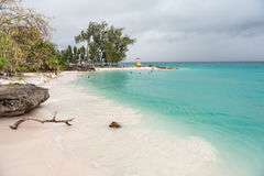BRIDGETOWN, BARBADOS - MARCH 16, 2014: Miami Beach in Barbados with Local People, Tourists and Cloudy Stormy Sky Stock Images