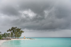 BRIDGETOWN, BARBADOS - MARCH 16, 2014: Miami Beach in Barbados with Local People, Tourists and Cloudy Stormy Sky Royalty Free Stock Photo