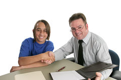 Bridging the Gap. A hispanic student and anglo teacher shaking hands in the spirit of cooperation.  Illustrates cooperation across generational or ethnic lines Royalty Free Stock Image