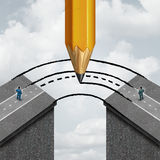 Bridging The Gap. Business partnership concept as a giant pencil drawing a joining road to connect divided businessmen as a cooperation symbol of support and Royalty Free Stock Photography