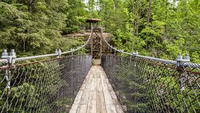 Bridging The Gap. Swing bridge crosses over a ravine. Pickett State Park. Jamestown, Tennessee Stock Photos