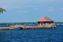 Bridging the Gap. This view of a small bridge and boat house bridges the gap for easy access Royalty Free Stock Images