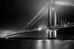 Bridging Verrazano Narrows. Verrazano-Narrows Bridge on a foggy night Royalty Free Stock Photography
