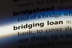Bridgingloan. Bridging loan word in a dictionary. bridging loan concept Stock Photography