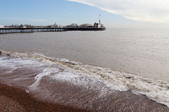 Bridgton pier, England. Waves at Brighton, United Kingdom in silent spring evening Royalty Free Stock Photos
