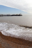 Bridgton pier, England. Waves at Brighton, United Kingdom in silent spring evening Stock Photos