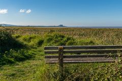 Bridgwater Bay Nature Reserve, England, UK. October 04, 2018: A bench with a view over the Bristol Channel and Hinkley Point Nuclear Power Station in the stock images