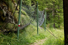 Bridle path, anti-rockfall mesh, in mountains. Side view Royalty Free Stock Photography