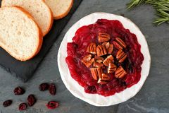 Brie topped with cranberries and pecans, overhead scene Royalty Free Stock Images