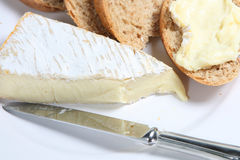 Brie and Bread. Fresh bread slices with soft brie de meaux cheese Royalty Free Stock Photography