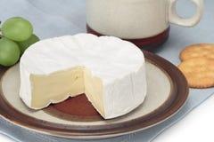 Brie for breakfast. Cheese brie cracker breakfast snack gourmet food Royalty Free Stock Image
