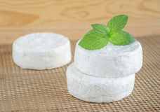 Brie and camembert cheese. With mint leaves Stock Photo