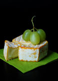 Brie/Camembert with Grapes Stock Images