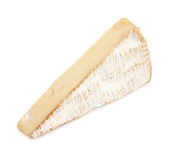 Brie cheese. Triangular section of slab of brie cheese, isolated on white background Royalty Free Stock Image
