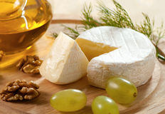 Brie cheese. With grapes and walnuts royalty free stock photo
