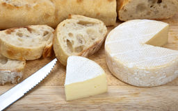 Brie cheese. With french banqueter on a wood counting board stock photo