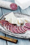 Brie cheese and air dried salami Royalty Free Stock Image