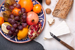 Brie cheese with bread and fruits Royalty Free Stock Photos