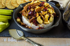 Brie cheese. Caramel nut and cranberry brie appetizer for Christmas party royalty free stock photo