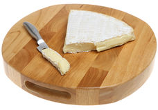 Brie Cheese on Cheeseboard. Royalty Free Stock Photos