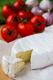 Brie cheese with cherry tomatoes Royalty Free Stock Images