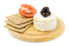 Brie cheese and crackers. Healthy snacks with fresh Brie cheese, organic crackers and olives. Isolated on white background royalty free stock photos