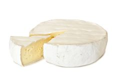 Brie cheese with cut slice isolated on white Stock Images