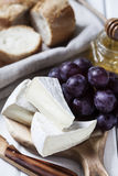 Brie cheese and grapes Stock Photography
