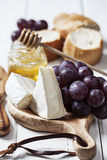 Brie cheese and grapes Royalty Free Stock Photo