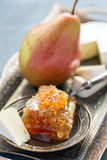 Brie cheese, honey and pear. Royalty Free Stock Photography