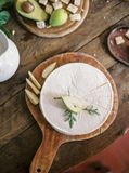 Brie cheese and pear stock photography