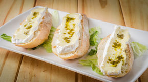 Brie cheese and pesto Stock Images