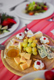 Brie Cheese. On a plate closeup stock photos