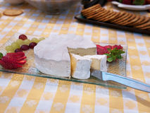 Brie cheese plate  with strawberry and grapes Royalty Free Stock Images