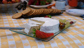 Brie cheese plate  with strawbery and grapes Royalty Free Stock Photo