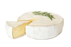 Brie cheese with rosemary and cut slice isolated on white Stock Image
