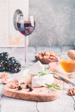 Brie cheese and slice on a wooden board Stock Photography
