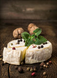Brie cheese with spices and mint Royalty Free Stock Images