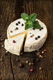 Brie cheese with spices and mint Royalty Free Stock Photo