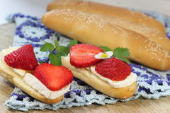 Brie cheese and strawberries. Brie cheese with strawberries on a bun with sesame seeds. soft focus royalty free stock image