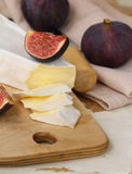 Brie cheese and sweet fruit  figs Royalty Free Stock Photo