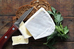 Brie Cheese On Wood Royalty Free Stock Photography