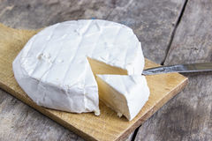 Brie Cheese. On A Wooden Board Stock Image