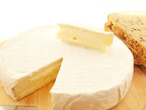 Brie  cheese on wooden desk with knife isolated Stock Images