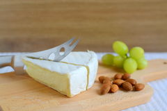 Brie cheese in wooden plate Stock Photo