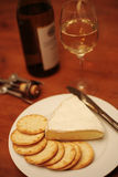 Brie crackers white wine Stock Images
