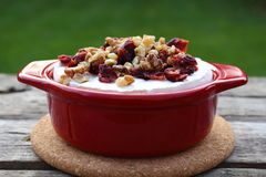 Brie Cranberry and walnuts in a pot ready for the oven. On old wooden planks Stock Photo