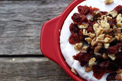 Brie Cranberry and walnuts in a pot ready for the oven. On old wooden planks Royalty Free Stock Images