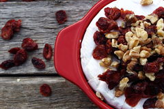 Brie Cranberry and walnuts in a pot ready for the oven. On old wooden planks Royalty Free Stock Photography