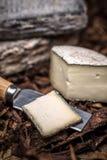 Brie cream cheese. Slice of artisan brie cream cheese stock images